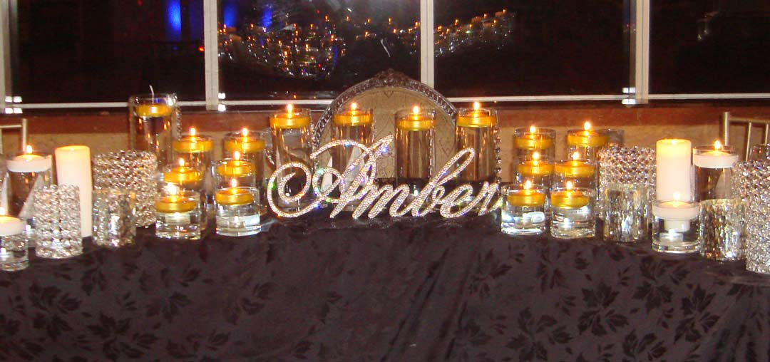 Crystal-Sweet-16-Candelabras-with-Gold-Floating-Candles