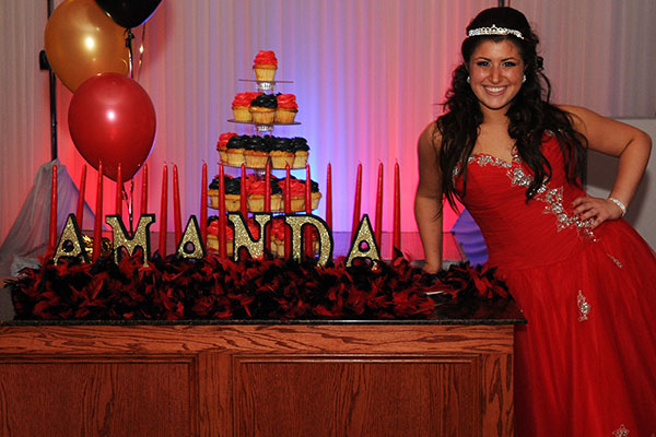 Amanda-with-sweet-16-candelabra-and-cupcake-tower